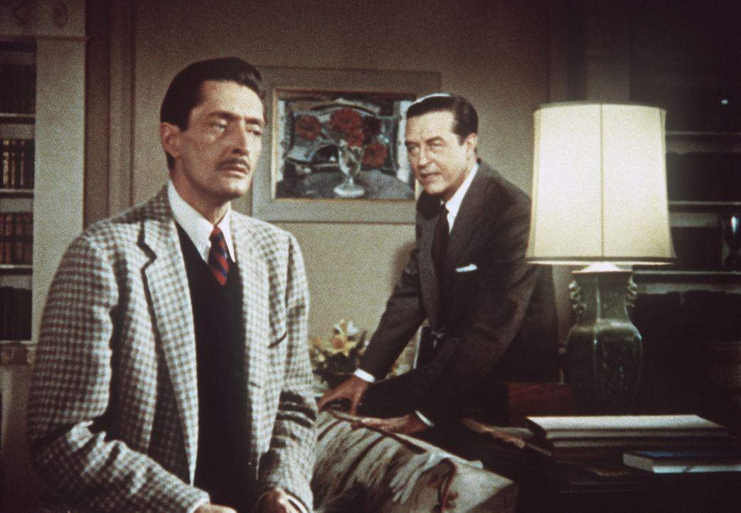 Tony Wendice (Ray Milland, r.) erpresst seinen früheren Schulkameraden Lesgate (Anthony Dawson, l.) dazu, den Mord an seiner Frau Margot für ihn zu... - Bildquelle: Warner Bros.
