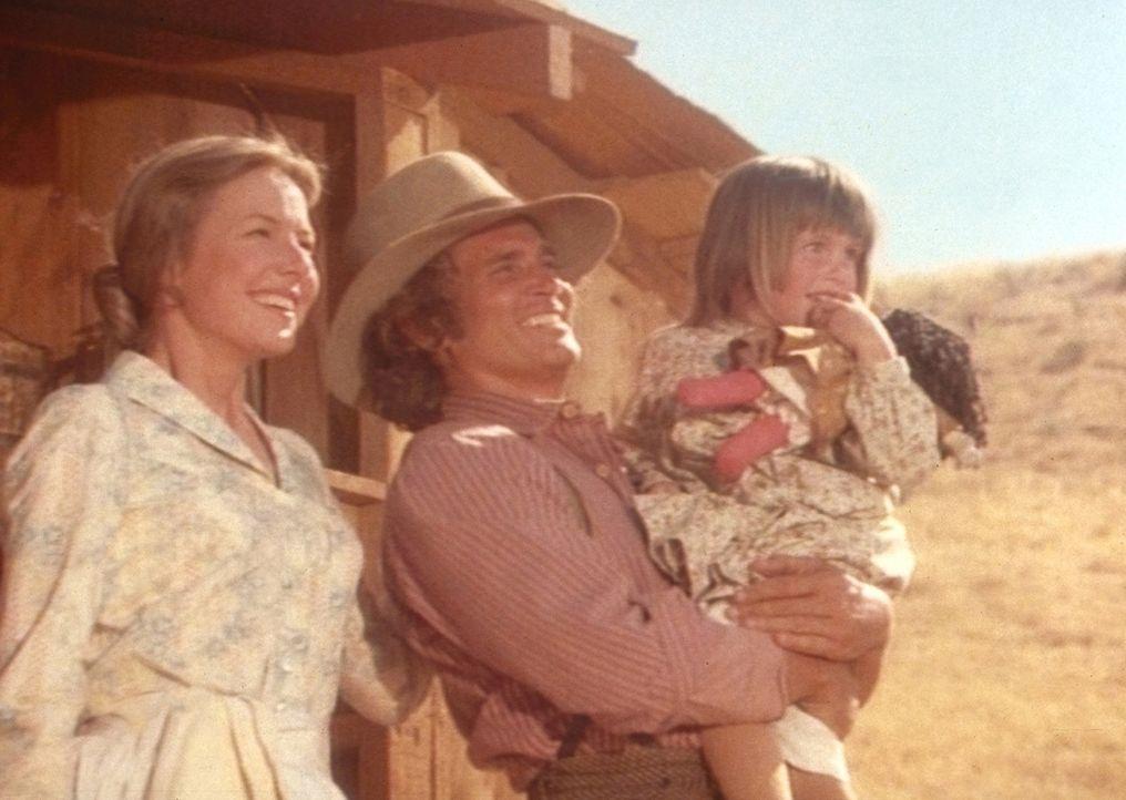 Caroline (Karen Grassle, l.), Charles (Michael Landon, M.) und Carrie wünschen Mary und Laura viel Glück an ihrem ersten Schultag. - Bildquelle: Worldvision