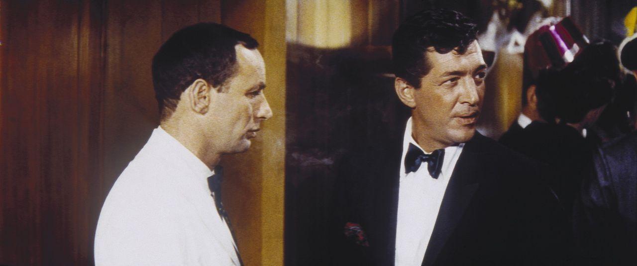 Der Plan ist tatsächlich aufgegangen. Doch da gehen die Probleme für Sam Harmon (Dean Martin, r.) und Jimmy Foster (Peter Lawford, l.) erst so ric... - Bildquelle: Warner Bros.