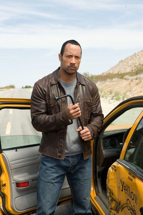 Noch glaubt Jack Bruno (Dwayne Johnson), dass die Typen, die ihn verfolgen, die Muskelmänner eines Ganoven sind, mit dem er noch eine Rechnung offen... - Bildquelle: Disney Enterprises, Inc.  All Rights Reserved