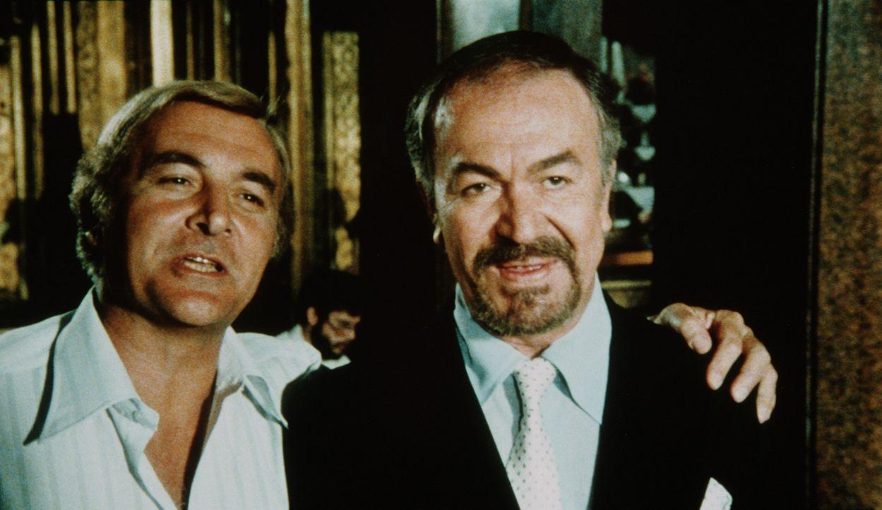 Öl-Milliardär Burns (Robert Loggia, l.) und sein Beauftragter Zakar (Angelo Infanti, r.) versprechen sich von der sensationellen Erfindung noch be...