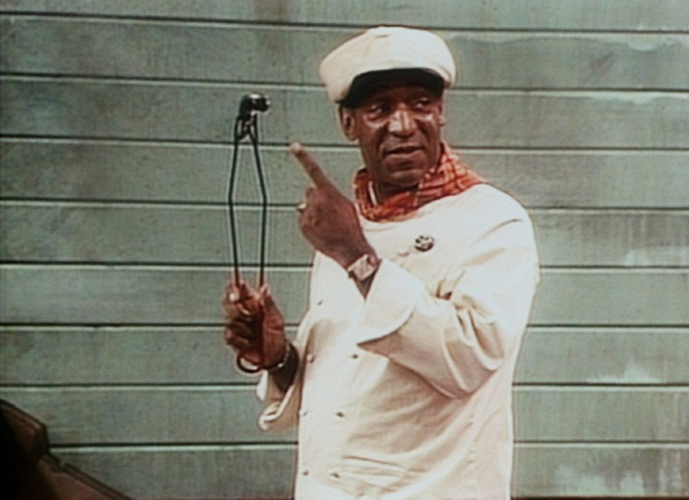 Cliff (Bill Cosby) zeigt Elvin, welches Stück Fleisch er bekommt, wenn er nochmal eine abfällige Bemerkung über seinen Körperumfang macht. - Bildquelle: Viacom