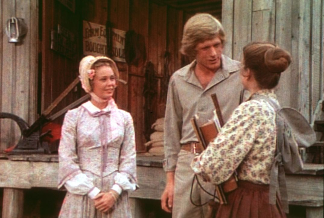 Laura (Melissa Gilbert, r.) tobt vor Eifersucht. Vergeblich versucht ihr Almanzo (Dean Butler, M.) zu erklären, dass Brenda Sue (Tisch Raye, l.) nu... - Bildquelle: Worldvision