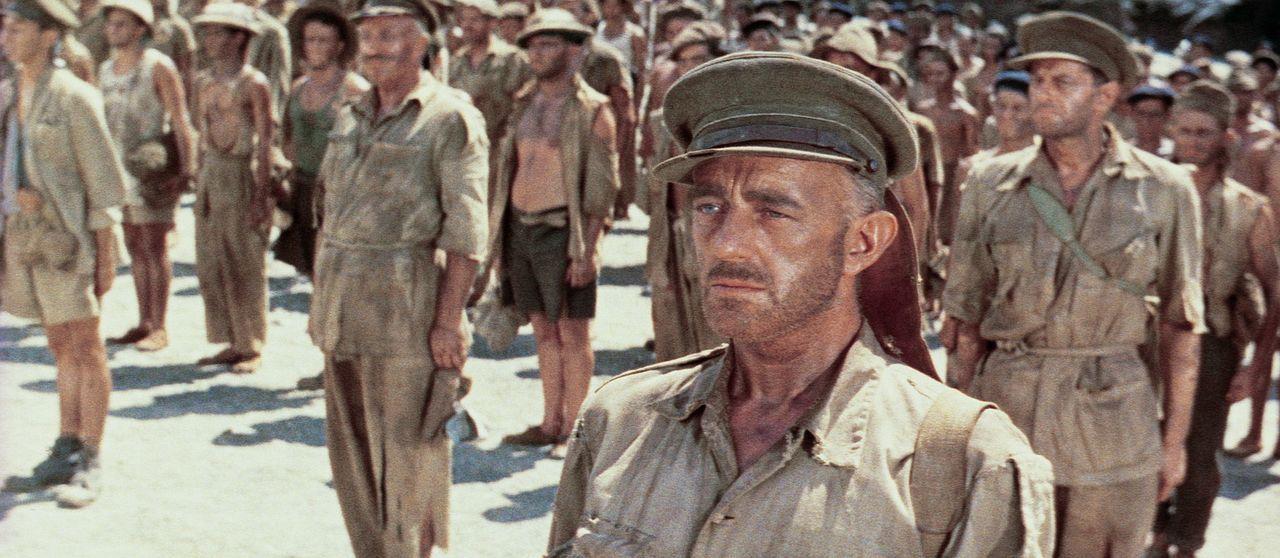 Der englische Kriegsgefangene Oberst Nicholson (Alec Guinness, r.) soll zusammen mit den anderen Häftlingen eine für die Japaner strategisch wicht...