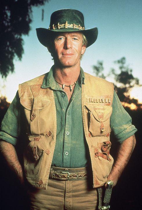 """In den australischen Outbacks meistert Krokodiljäger Mick """"Crocodile"""" Dundee (Paul Hogan) jede Gefahr. Im Großstadtdschungel von New York jedoch h... - Bildquelle: Paramount Pictures"""