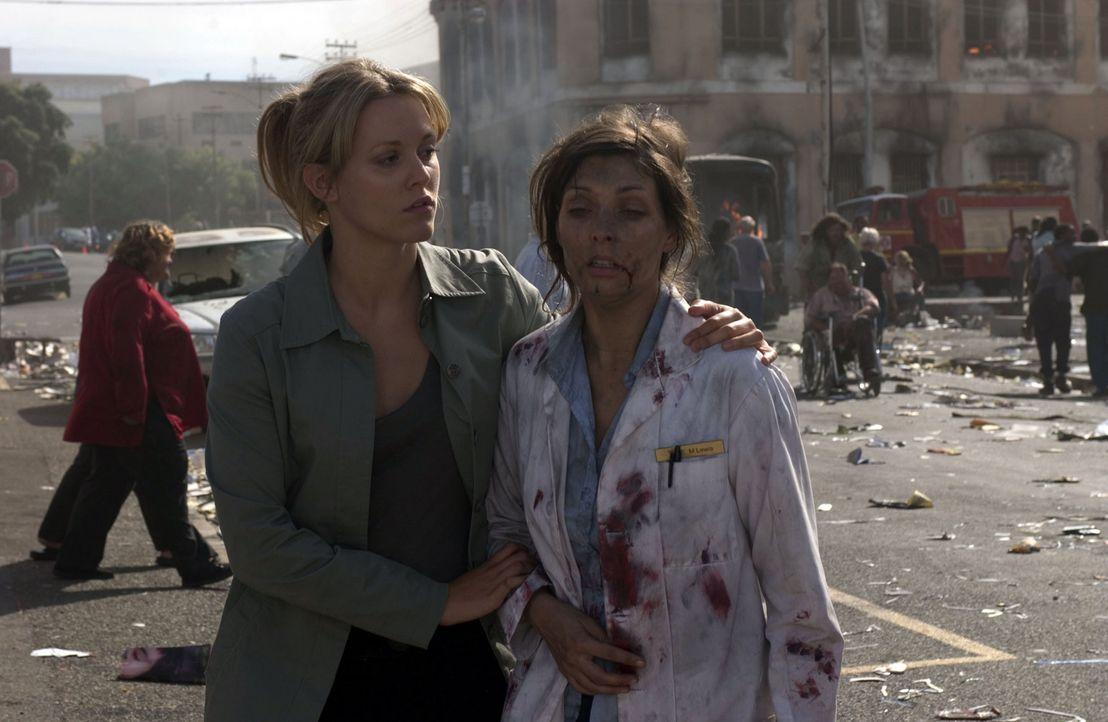 Ginny McKillop (Clemency Burton-Hill, l.), Assistentin von Dr. Austin Shepard, versucht zu helfen, wo sie nur kann ? - Bildquelle: Hallmark Entertainment