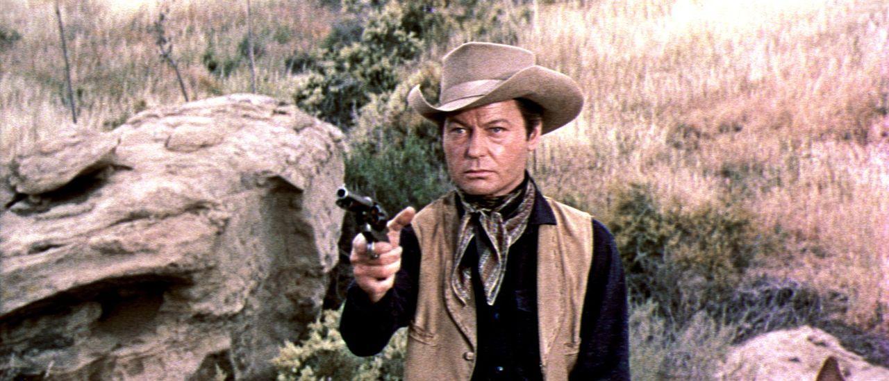 Der skrupellose Troop (DeForest Kelley) ist kein Freund langer Worte - er greift lieber gleich zur Waffe ... - Bildquelle: Allied Artists Pictures
