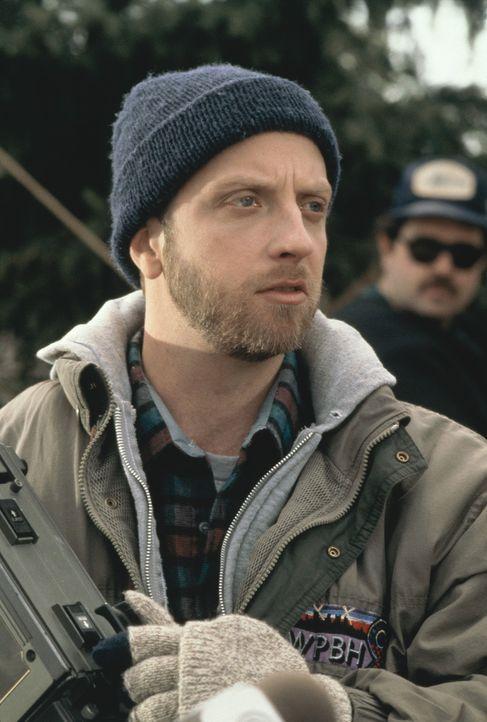 Das seltsame Verhalten von Wetterfrosch Phil lässt den Kameramann Larry (Chris Elliott) doch etwas stutzig werden ... - Bildquelle: Columbia TriStar