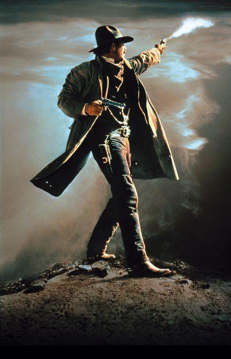 Wyatt Earp (Kevin Costner) wird von seinem Vater zu einem Mann erzogen, der an das Gesetz glaubt. Doch Wyatt hat seine eigenen Methoden im Kampf um... - Bildquelle: Warner Bros.