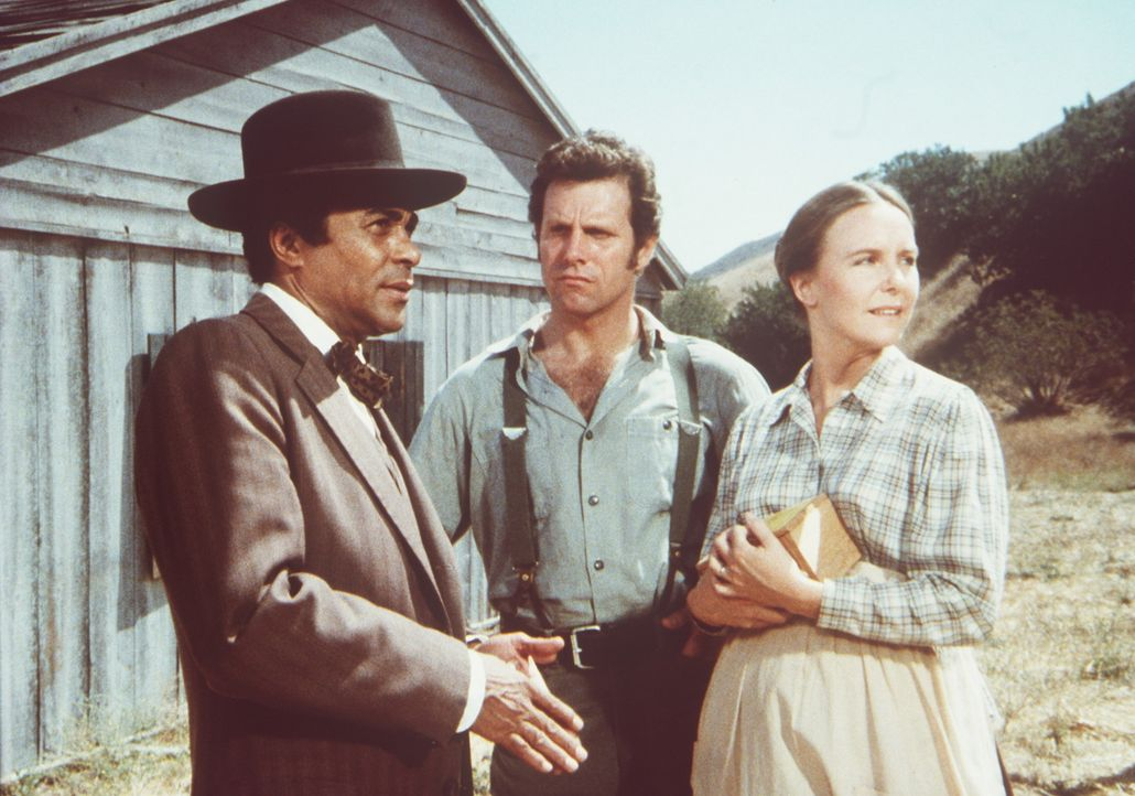 Dr. Caleb Ledoux (Don Marshall, l.) gibt der schwangeren Jenny Sherman (Anne E. Lurry, r.) einen Rat, aber ihr Mann Nathan (John Shearin, M.) zweife... - Bildquelle: Worldvision
