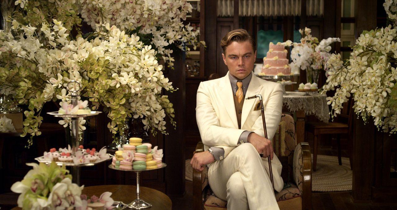 Seine obsessive Liebe zu seiner Jugendfreundin Daisy, droht alle Beteiligten ins Unglück zu stürzen: Jay Gatsby (Leonardo DiCaprio) ... - Bildquelle: 2012 Warner Brothers