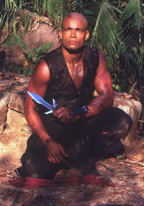 In letzter Sekunde kann Solo (Mario Van Peebles) in den Dschungel fliehen, doch dort ist er noch lange nicht in Sicherheit ... - Bildquelle: Triumph Enterprises