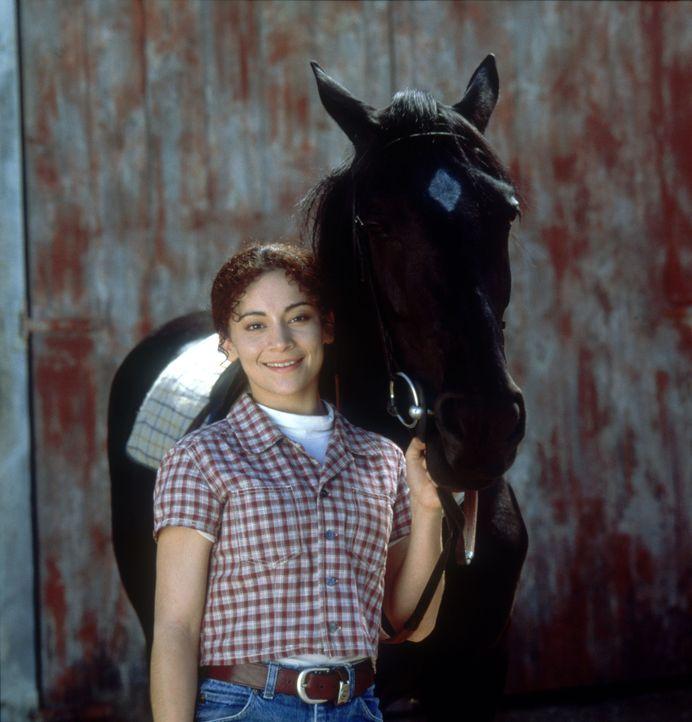 Obwohl ihr Vater bei einem Reitunfall ums Leben kam, möchte Corrie (Krissy Perez) unbedingt Jockey werden. Ihre Mutter will das unter allen Umstän... - Bildquelle: Disney