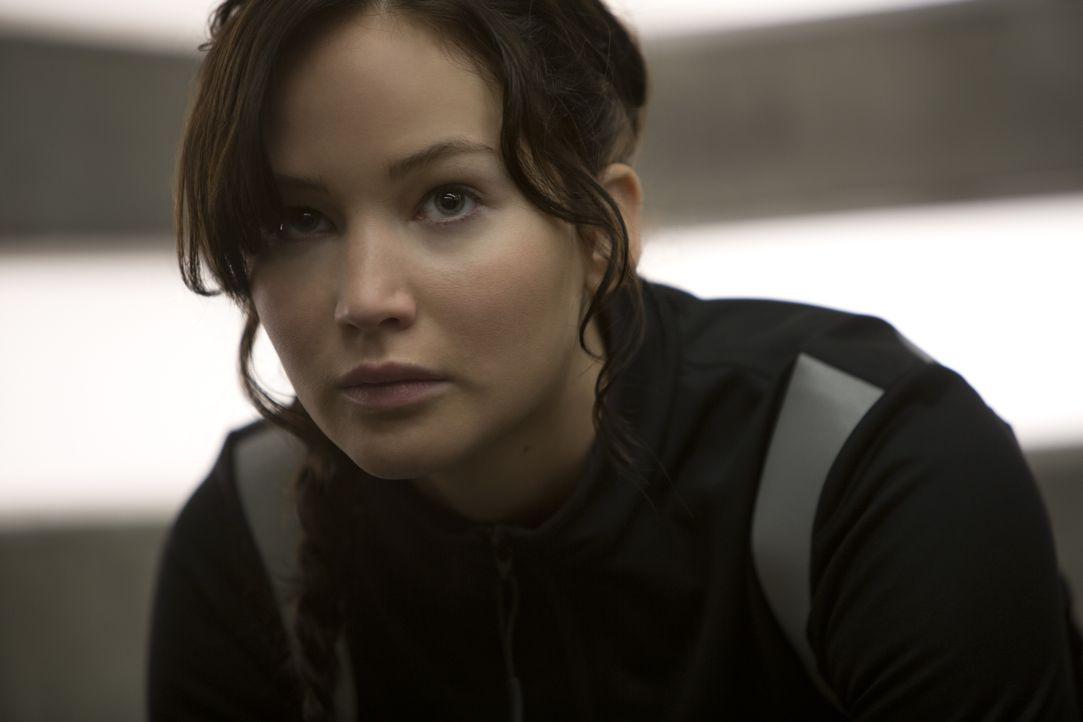 Nachdem Katniss (Jennifer Lawrence) und Peeta die Hungerspiele gemeinsam überlebt haben, sieht ihre Zukunft zunächst sehr rosig aus. Doch dann müsse... - Bildquelle: Studiocanal GmbH