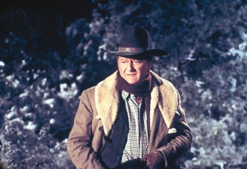 Marshall J.D. Cahill (John Wayne) steht vor seinem schwersten Fall: Seine beiden minderjährigen Söhne sind an einem Banküberfall beteiligt. - Bildquelle: Warner Bros.