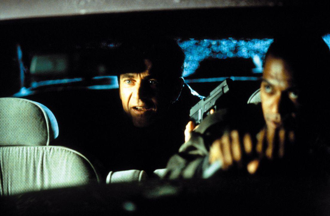 Ohne es zu wissen, wurde Jerry Fletcher (Mel Gibson, l.) vor Jahren zum Killer ausgebildet. Als er erfährt, dass Agent Lowry (Cylk Cozart, r.) gar n... - Bildquelle: Warner Bros. Pictures