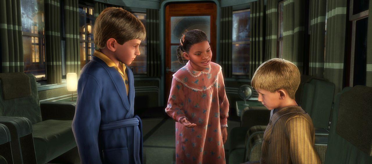 Am Nordpol angekommen müssen der Junge (l.) und seine neue Freundin (M.) einen schüchternen Jungen (r.) zum Aussteigen überreden ... - Bildquelle: Warner Bros. Pictures