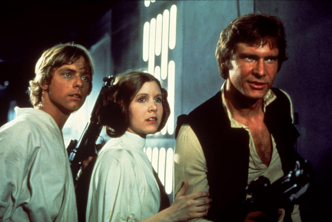 Luke (Mark Hamill, l.), Prinzessin Leia (Carrie Fisher, M.) und Han Solo (Harrison Ford, r.) versuchen, Darth Vader und seinen Schergen zu entkommen... - Bildquelle: 1997 Lucasfilm Ltd. All rights reserved.